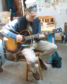 A happy customer plays his better-than-new guitar.
