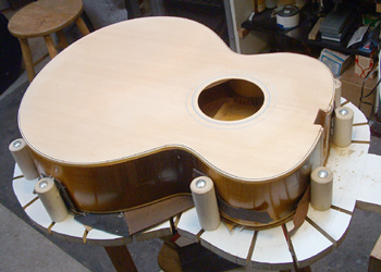 The top is attached, and the binding channels routed. The original binding has been saved, and is in good enough condition to re-use. The guitar will appear much more original because of details like this.