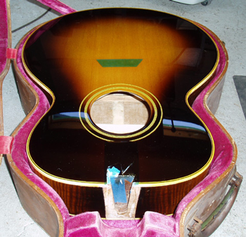An accurate Gibson sunburst finish was applied by our friend James Campbell-Drury; the sides and back are original.