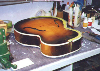 The binding is attached, and is being pared level with the top and sides using scrapers. I had to be super careful not to touch the existing finish, as this guitar is not being refinished! It is always best to leave the original finish alone.
