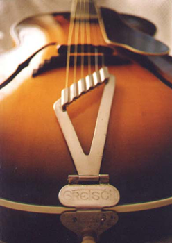 A bottom view showing the binding and the beautiful Art Deco tailpiece of this lovely guitar.