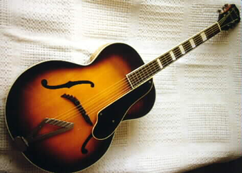 A full view of the restored guitar.