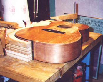 After bending and fitting, the side is glued on and the guitar placed into a mold made from the exact profile-this ensures exact fit.