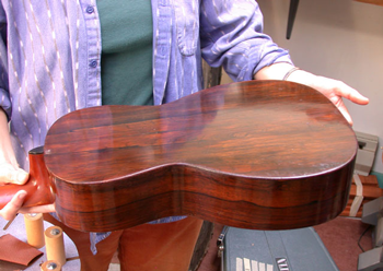 The back and sides are beautifully figured old-growth Brazilian Rosewood, and in very fine shape for their age. This one would be worth saving for the wood alone.