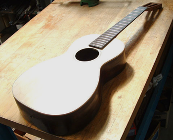 The guitar ready for finishing and bridge gluing.
